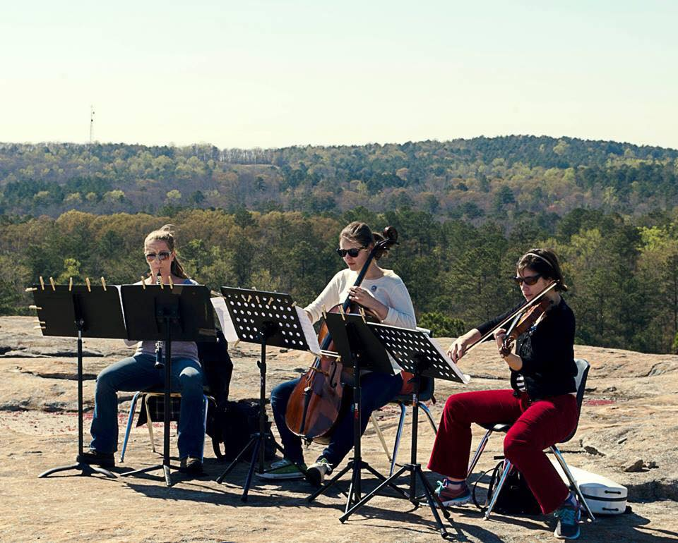 "Performance of Wood's ""Diamorpha Smalii: a granite phenomenon"" on top of Arabia Mountain as part of the 2015 Monadnock Muse Celebration, Lithonia, GA. Pamela Holloway, oboe; Tracy Woodard, violin; Jean Gay, cello."