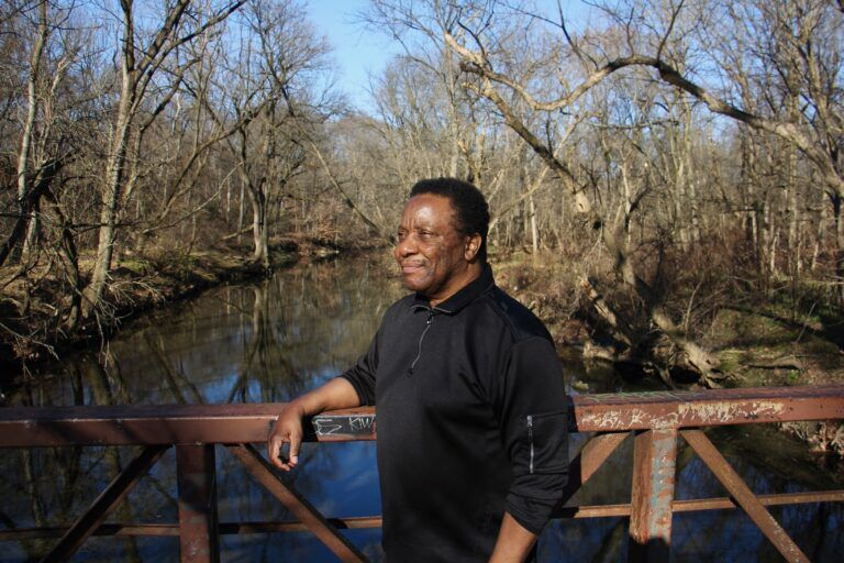 Portrait of Randy Gibson on bridge over Tacony Creek