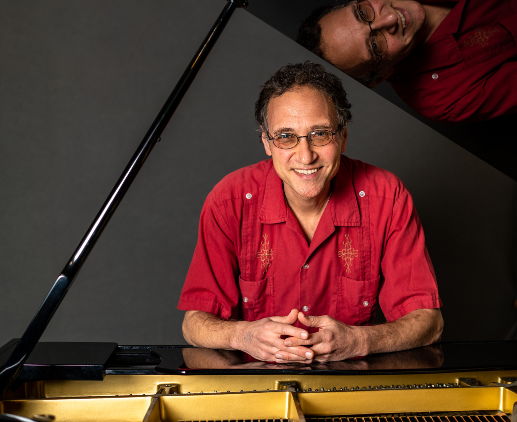 Portrait of Paul Safar at piano